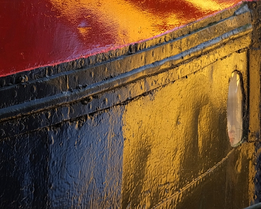 Colors reflected in a boat hull