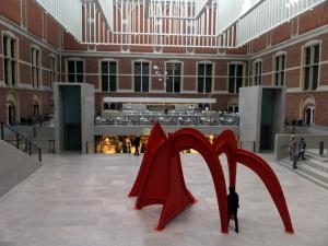 Man walking under orange Calder Rijksmuseum--DSCF6751