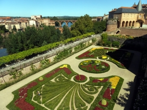 A beautiful formal garden is located on the grounds of the museum.