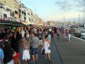The town features a wide and long boardwalk along the marina. It is the center of activity day and night.