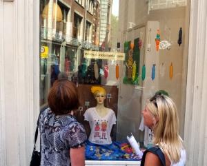 Two ladies window shop at De Wallen's Condomerie.