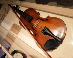 Objects which belonged to the children, such as this violin, are displayed.