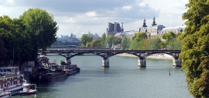 The Seine, with its grand bridges and surrounding buildings, is a feast for the eyes.
