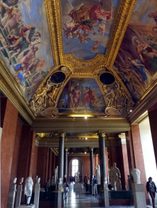 In the Louvre, some of the the rooms' decorations almost outshine the art within it.