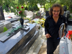 This man is also something of a Pere Lachaise tradition. I read in a travel guide that he will approach you and offer to show you to the graves of the famous, but then he expects to be paid for his services. He offered to show us around, but we were on our way out by then. Here he is next to the grave of Edith Piaf.