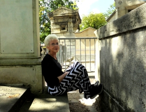 Sarah resting between graves, as I took pictures of Jim Morrison's.