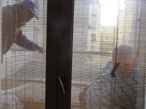 Workmen pounding away on our bedroom windowsill.
