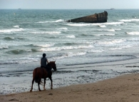 All over Normandy, memories of the war are kept alive by artifacts that remain to this day, such as this part of the artificial harbor assembled in the days following D-Day.
