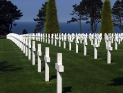 This is the beautiful and solemn American Cemetery overlooking the English Channel in Colleville-sur-Mer, Normandy, France. It is the final resting place for 9,387 Americans who died on D-Day and in the subsequent Battle of Normandy.