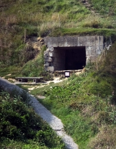 "The Nazis had created the ""Atlantic Wall"" to make any attempt at invasion very costly. This is what remains of a bunker overlooking Omaha Beach."