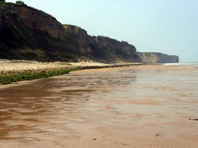 """Omaha Beach was the site of some of the most courageous and costly actions by American troops. They had to take the German positions on those cliffs. Many died, but they ultimately succeeded. The movie """"Saving Private Ryan"""" begins on this beach."""