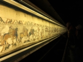 """Bayeux' main """"claim to fame"""" is the Bayeux Tapestry. This remarkably preserved, 230-foot long work of art dates from the 11th or 12th century. It is well worth a visit."""