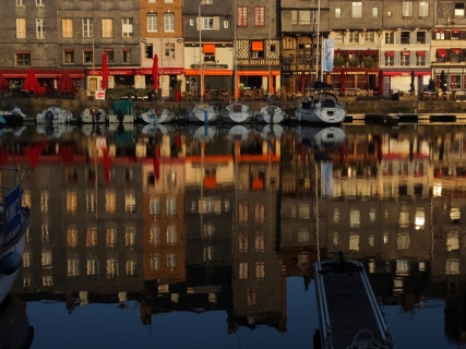Many buildings in Honfleur are tall and skinny because they authorities created a tax structure based on the width of the buildings.