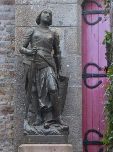 Interesting details await around every turn, such as this statute of Joan of Arc at the entrance to a chapel. Some of her visions to liberate France came from the Archangel Michael (or in French, Michel).