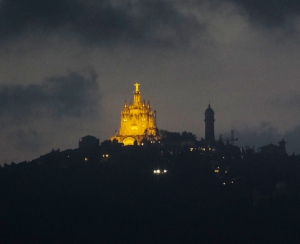 At night, the view changed completely. The Church of the Sacred Heart of Jesus on Mount Tibidabo glowed through the distance and passing clouds.