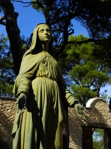 A statue of the Virgin Mary beseeching the heavens stands on the grounds of Beauregard.