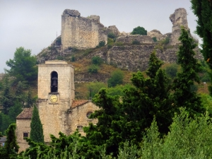 Ruins of the castle of the Duke of Guise are visible in the hills above the town.
