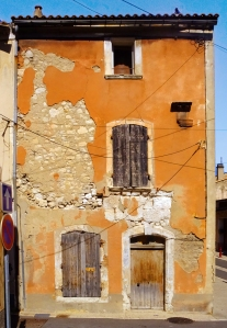 The colors and textures of many ancient facades in the town appealed to me as a photographer.