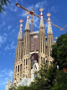 Gaudí's crowning achievement is the Sagrada Familia. Construction of this Catholic basilica began in 1882. It is funded by donations, and by the paid admission of millions of tourists. Gaudí knew he wouldn't live to see its completion, which is projected to happen in 2026, 100 years after his death.