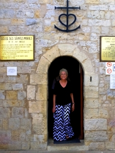 Sarah exiting Eglise des Saintes Maries.--DSCF5915