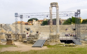 This Roman theatre is used for present-day performances. The ugly scaffolding is used to support stage lighting. The two columns are all that is left of the structure that supported a roof.