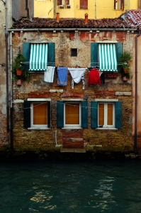 Our windows the three at water level. The center window used to be a door. Many Venetian structures have canal-side doors.