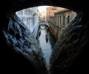 "This view through one of the window grates in the ""Bridge of Sighs"" would be a prisoner's last glimpse of the city. It's easy to see how the condemned might sigh heavily, giving the bridge its name."