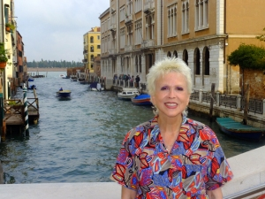 "We were excited to be in Venice. Here Sarah is standing on a bridge over ""our"" canal."