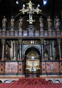 The tiny central figure praying at the central altar of St. Mark's shows the scale of this massive basilica.