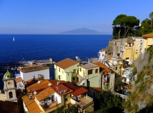 Sorrento lies on the Bay of Naples, with the unmistakable cone of Mount Vesuvius in the distance.