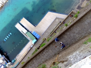 This view looks straight down from a walkway hundreds of feet above the shoreline.