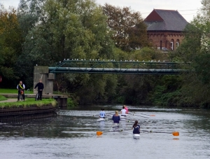 The River Lea is a popular spot for rowing teams to practice. The coaches ride alongside the rowerson bicycles, monitoring progress and shouting instructions.