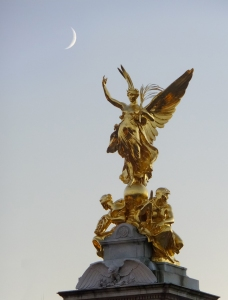 The moon was rising - or perhaps setting - over Buckingham Palace...