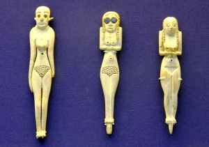 These rare ivory figurines show the Egyptians' ideals of feminine beauty. The bald one probably had a wig.