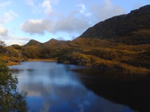 The park is about 40 square miles of lakes, woodlands, and mountain peaks. At this altitude, the lush green for which Ireland is famous had turned to gold with the coming of autumn.