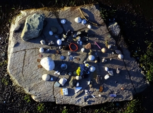 There is a tradition of leaving offerings on the stone altar at the center of the circle.