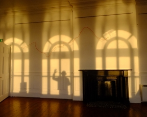 Here's my shadow visiting a minimalist modern art exhibit in the town art gallery. That sqiggly line on the wall is one of the pieces on exhibit. I found the shadows more interesting!