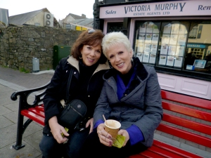 Here Sarah and her sister Deas, visiting from Florida, enjoy rest and refreshment in the square.