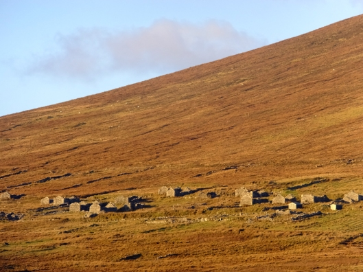 At the base of Slievemore Mountain are the crumbling remains of about 80 homes. The place is called, simply, the Deserted Village.