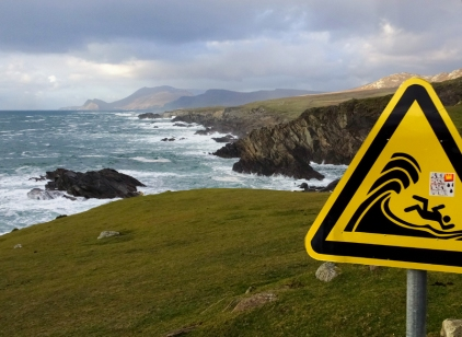There are no railings or barriers. Signs warn visitors not to take the wild surf for granted.