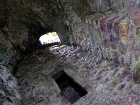 The wooden floors and stairs to the upper levels of Kildamhnait have long since rotted away.