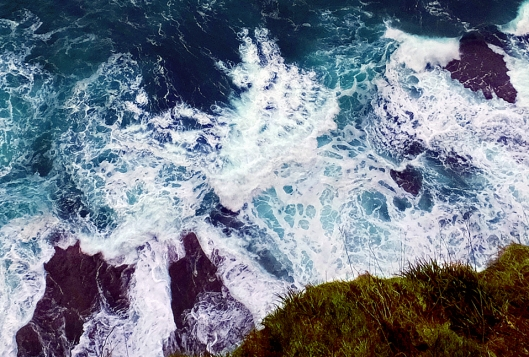 Visitors can go to an observation deck at the very edge of the cliffs. This view is looking straight down into the churning surf.