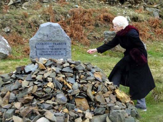 We retraced their journey by car, but every year people walk the route to commemorate the tragedy that occurred. Here Sarah places a stone on a memorial to the victims.