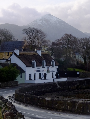 We got to know another Wesport pub pretty well. Cronin's Sheebeen is a short walk from where we were staying. In this view, a dusting of snow tops Croagh Patrick in the distance.