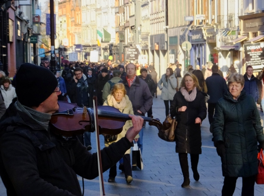 Modern life thrives in old and new Dublin. Grafton Street is a famous shopping destination.
