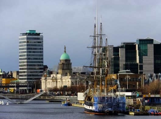 Old Dublin lives right alongside new Dublin. The green-domed Customs House and the Jeanie Johnston Tall Ship and Famine Museum (the latter undergoing restoration) are framed by modern buildings.