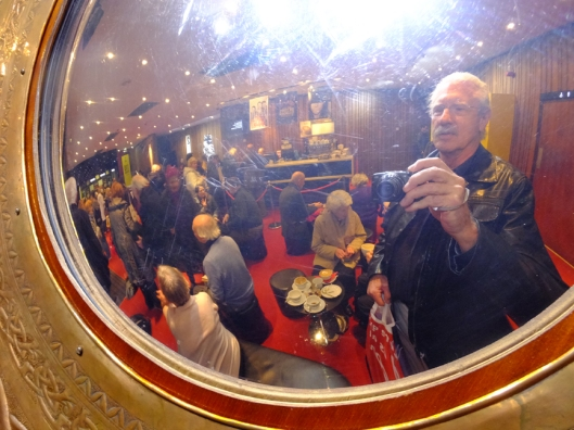 This is a selfie-portrait of me in the Abbey's lobby, seen through the fisheye lens of an ornate mirror.