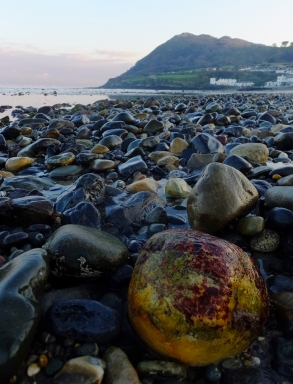 The beach itself is largely composed of colorful pebbles rounded by the sea.