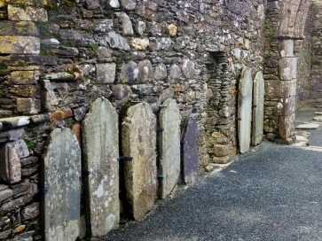 Gravestones line the walls of the cathedral, marking the graves of those buried below it.