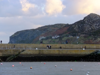 Beyond Howth's harbor is the rocky promentory known as Howth Head.